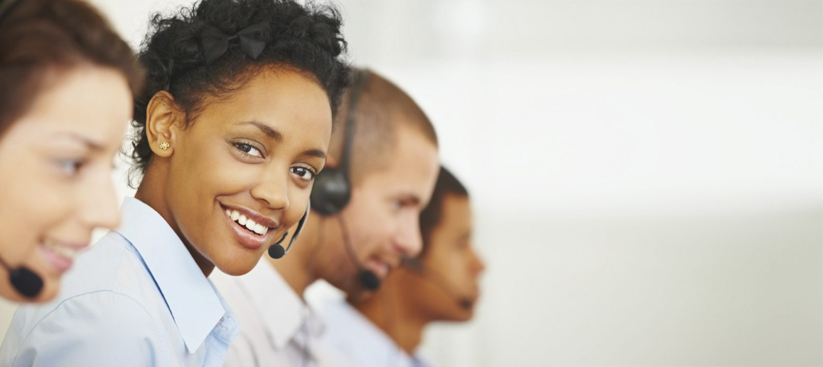 Smiling call centre employees